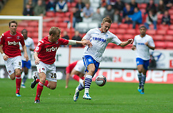 LONDON, ENGLAND - Saturday, October 8, 2011: Tranmere Rovers' Adam McGurk and Charlton Athletic's Chris Solly in action during the Football League One match at The Valley. (Pic by Gareth Davies/Propaganda)