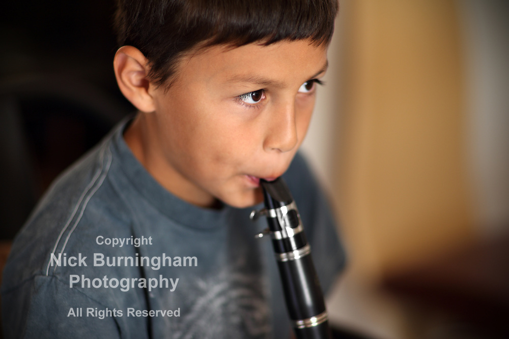 Young boy playing on his clarinet - EXCLUSIVELY AVAILABLE HERE