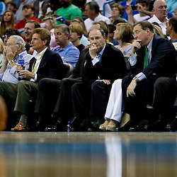 April 15, 2012; New Orleans, LA, USA; New Orleans Hornets newly named owner Tom Benson along with (right to left) Saints, Executive Vice President/Chief Financial Officer Dennis Lauscha and NBA governor Jac Sperling watch courtside during the second quarter of a game against the Memphis Grizzlies at the New Orleans Arena.   Mandatory Credit: Derick E. Hingle-US PRESSWIRE