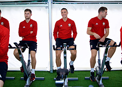 CARDIFF, WALES - Monday, September 3, 2018: Wales' Ben Davies, James Chester and Sam Vokes on warm-up bikes in the pre-activation tent before a training session at the Vale Resort ahead of the UEFA Nations League Group Stage League B Group 4 match between Wales and Republic of Ireland. (Pic by David Rawcliffe/Propaganda)