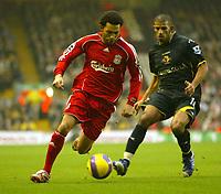 Photo: Aidan Ellis.<br /> Liverpool v Watford. The Barclays Premiership. 23/12/2006.<br /> Liverpool's Jermain Pennant (L) beats Watford's Hameur Bouazza