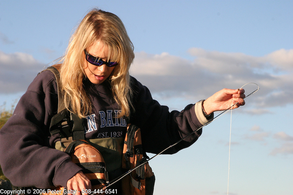 Kelly Kinney of Denver CO. fishing on the Yellowstone River during the 2006 Cuttie-Thon fly fishing marathon.....Ms. Kinney went on to finish 20 miles of the 27 mile - 34 hour marathon.<br />