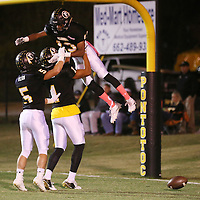 Lauren Wood | Buy at photos.djournal.com<br /> Pontotoc's Darryl Dilworth is lifted into the air by teammate Austin Morphis after Dilworth scored a touchdown during Friday night's game against Itawamba.