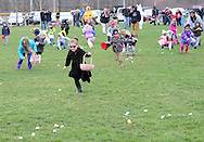 A group of children run to find easter eggs during a hunt sponsored by the Feasterville Business Association and the Friends of the Lower Southampton Library Saturday March 19, 2016 at Russell Elliot Park in Feasterville, Pennsylvania. (Photo By William Thomas Cain)
