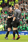 Referee Willie Colium has to get hands on with Zdenek Zlamal of Hearts during the William Hill Scottish Cup Final match between Heart of Midlothian and Celtic at Hampden Park, Glasgow, United Kingdom on 25 May 2019.