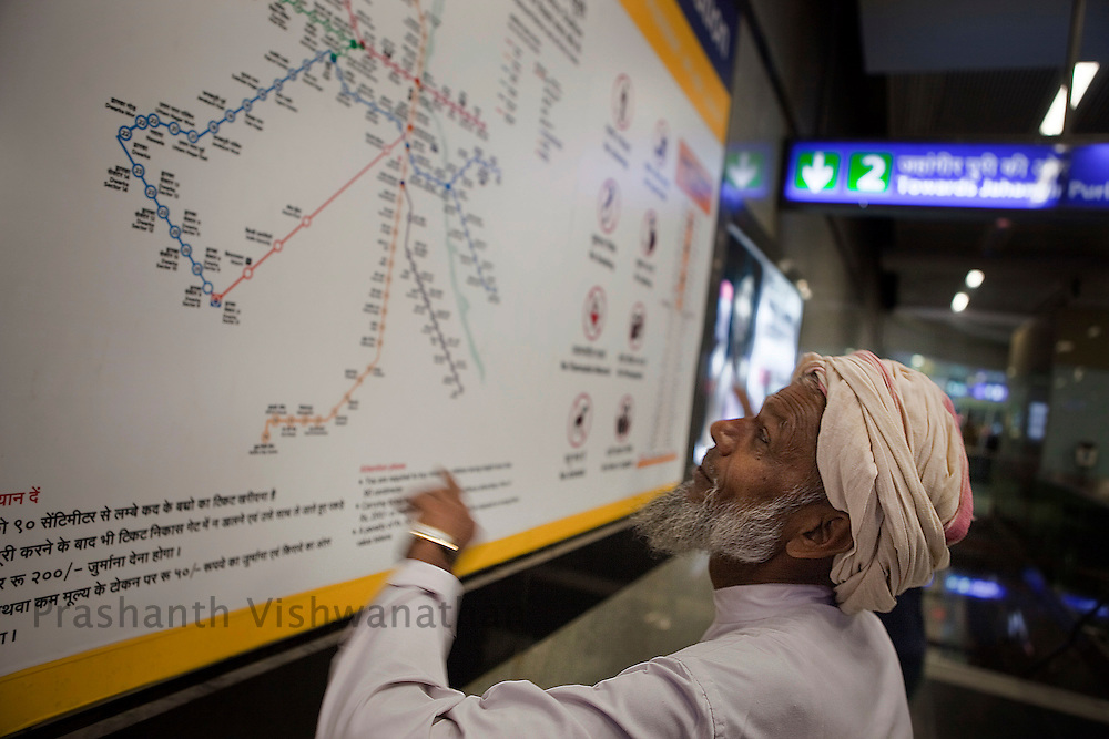 Raheez Ahmad, 67  looks at a map locating his destination inside the Central Secratariat station as he changes his route from one line to another of the Delhi Metro network in New Delhi, India, on Friday, October 22, 2010. Photographer: Prashanth Vishwanathan/HELSINGIN SANOMAT