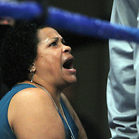 "Dominga Torres-Rivera, mother of fighter Orlando Cruz, yells instructions to her son during his fight against Jorge Pazos at the Kissimmee Civic Center in Kissimmee, Florida, on Friday, October 19, 2012. The Puerto Rican Cruz recently described himself as ""a proud gay man"" and the first active boxer having pronounced so, in boxing history. Cruz won the fight in a 12-round decision. (AP Photo/Alex Menendez)"