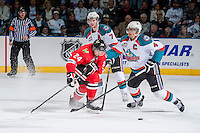 KELOWNA, CANADA - APRIL 18: Madison Bowey #4 of the Kelowna Rockets checks Mathew Dumba #24 of the Portland Winterhawks as he tries to receive a pass on April 18, 2014 during Game 1 of the third round of WHL Playoffs at Prospera Place in Kelowna, British Columbia, Canada.   (Photo by Marissa Baecker/Shoot the Breeze)  *** Local Caption *** Madison Bowey; Mathew Dumba;