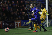 AFC Wimbledon midfielder Dean Parrett (18) and Sutton United Roarie Deacon (21) shoots at during the The FA Cup third round replay match between AFC Wimbledon and Sutton United at the Cherry Red Records Stadium, Kingston, England on 17 January 2017. Photo by Stuart Butcher.