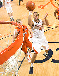 Virginia guard Calvin Baker (4) shoots a jump shot against Clemson.  The Virginia Cavaliers defeated the #12 ranked Clemson Tigers in overtime 85-81 at the John Paul Jones Arena on the Grounds of the University of Virginia in Charlottesville, VA on February 15, 2009.