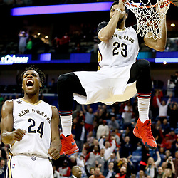 Dec 15, 2016; New Orleans, LA, USA; New Orleans Pelicans guard Buddy Hield (24) celebrates after a dunk by forward Anthony Davis (23) during the fourth quarter of a game against the Indiana Pacers at the Smoothie King Center. The Pelicans defeated the Pacers 102-95. Mandatory Credit: Derick E. Hingle-USA TODAY Sports