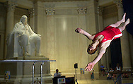 Gymnast Aaron Murphy, gives a mini trampoline demonstration, in front of the Ben Franklin statue, at the Franklin Institute, during the kickoff event for the U.S. Gymnastics Championships, Tuesday, June 26, 2000, in Philadelphia.