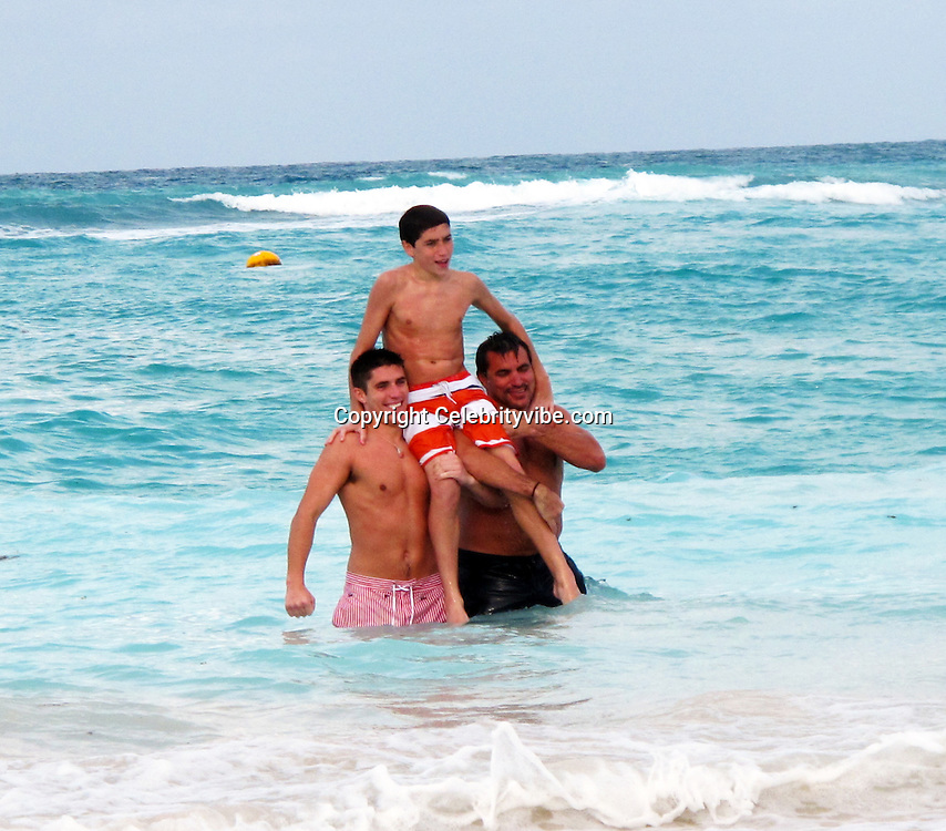 **EXCLUSIVE**Todd English, with sons, Oliver and Simon.Chef Todd English swims in the ocean and has a little too much fun with his sons on the beach in St. Barth.St. Barth, Caribbean.Wednesday, December 22, 2010.Photo By CelebrityVibe.com.To license this image please call (212) 410 5354; or Email: CelebrityVibe@gmail.com ; website: www.CelebrityVibe.com