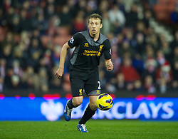 STOKE-ON-TRENT, ENGLAND - Boxing Day Wednesday, December 26, 2012: Liverpool's Lucas Leiva in action against Stoke City during the Premiership match at the Britannia Stadium. (Pic by David Rawcliffe/Propaganda)