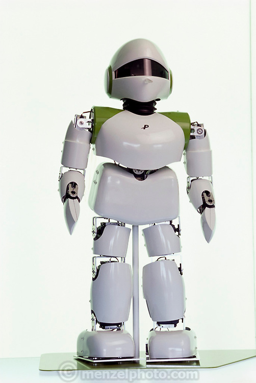 """Pino, short for Pinocchio (after the fabled wooden puppet that becomes a human boy), is a full-bodied, child-sized, humanoid robot. Even before it demonstrates the ability of a wide range of bipedal movements it already has a national following in Japan after the release of a music video called """"Can You Keep a Secret"""" in which the robot stars alongside one of Japan's most popular recording artists, Hikaru Utada. It has elevated Tatsuya Matsui, the artist who created the robot design, to celebrity status. The robot project is part of a large ERATO grant from the Japan Science and Technology Corporation, a branch of the Science and Technology Agency of the Japanese government. Project creator Hiraoki Kitano believes that the aesthetics of a robot are important in order for it to be accepted by humans into their living space. At the Kitano Symbiotic Systems, Tokyo, Japan."""