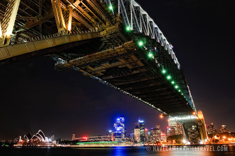 Night shot of Sydney Harbour Bridge and skyline of Sydney city looking back towards Dawes Point and taken from Milsons Point. Sydney Opera House is at extreme left.