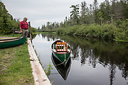 Brule River fishing guide Damian Wilmot makes sure his restored 1900-era Lucius Guide Canoe is ready for a fishing excursion beginning at Stone's Bridge Landing near Lake Nebagamon, Wisconsin.