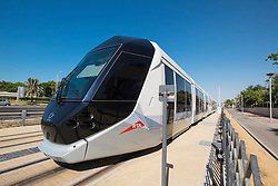 Tram on new Dubai Tram system in Marina district of Dubai United Arab Emirates