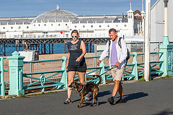 © Licensed to London News Pictures. 02/08/2020. Brighton, UK. Members of the public enjoy the early morning sunshine to exercise on the promenade in Brighton and Hove. Photo credit: Hugo Michiels/LNP