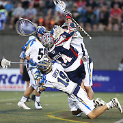 Ryan Boyle #14 of the Boston Cannons falls onto Kevin Drew #19 of the Charlotte Hounds after being pushed by Adam Ghitelman #8 of the Charlotte Hounds during the game at Harvard Stadium on May 17, 2014 in Boston, Massachuttes. (Photo by Elan Kawesch)