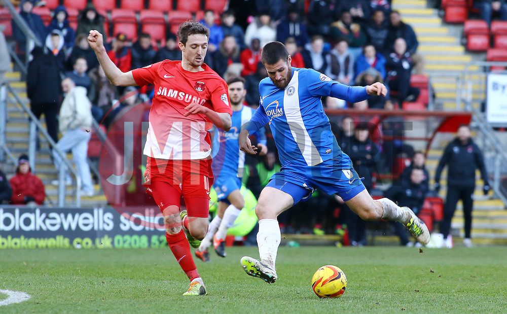 Peterborough United's Michael Bostwick in action with Leyton Orient's David Mooney - Photo mandatory by-line: Joe Dent/JMP - Tel: Mobile: 07966 386802 08/02/2014 - SPORT - FOOTBALL - Leyton - Brisbane Road - Leyton Orient v Peterborough United - Sky Bet League One