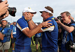 Team Europe's Sergio Garcia (left) and Ian Poulter celebrate after Europe win the Ryder Cup during the Singles match on day three of the Ryder Cup at Le Golf National, Saint-Quentin-en-Yvelines, Paris.
