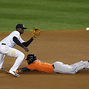 Pinch runner Jonathan Villar, Houston Astros, steals second base as Didi Gregorius takes the catchers throw during the New York Yankees Vs Houston Astros, Wildcard game at Yankee Stadium, The Bronx, New York. 6th October 2015 Photo Tim Clayton for The Players Tribune