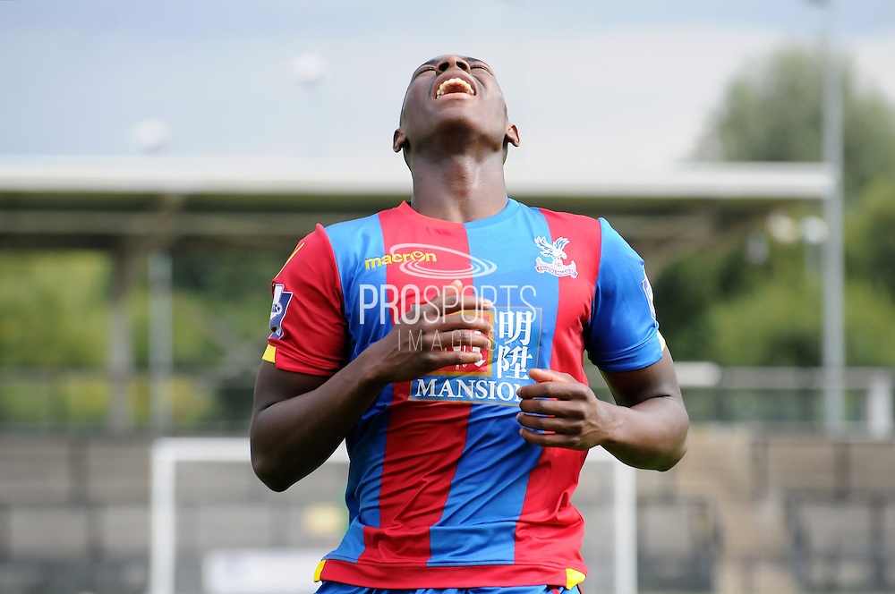 Sullay KaiKai winches as he has his penalty saved during the U21 Professional Development League match between U21 Crystal Palace and U21 Bolton Wanderers at Selhurst Park, London, England on 17 August 2015. Photo by Michael Hulf.
