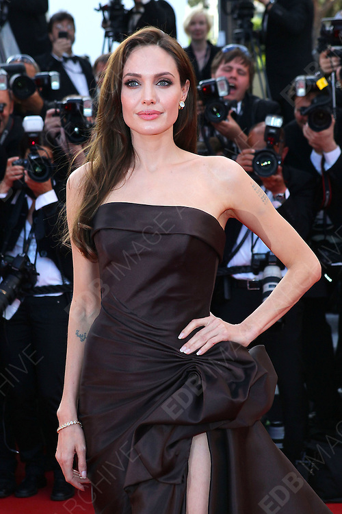 16.MAY.2011. CANNES<br /> <br /> ANGELINA JOLIE AT THE PREMIERE OF TREE OF LIFE AT THE 64TH CANNES INTERNATIONAL FILM FESTIVAL 2011 IN CANNES, FRANCE<br /> <br /> BYLINE: EDBIMAGEARCHIVE.COM<br /> <br /> *THIS IMAGE IS STRICTLY FOR UK NEWSPAPERS AND MAGAZINES ONLY*<br /> *FOR WORLD WIDE SALES AND WEB USE PLEASE CONTACT EDBIMAGEARCHIVE - 0208 954 5968*