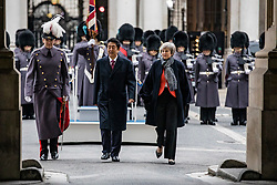 © Licensed to London News Pictures. 10/01/2019. London, UK. Prime Minister Theresa May (R) and Prime Minister of Japan Shinzo Abe (C) walking to Downing Street ahead of a bilateral meeting. Photo credit: Rob Pinney/LNP