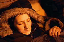 Homeless woman sleeping rough in the inner city streets,