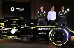 Drivers Niko Hulkenberg (left) and Daniel Ricciardo with Renault Managing Director Cyril Abiteboul during the Renault F1 Team 2019 season launch at Whiteways Technical Centre, Oxford.