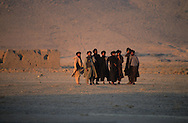 "Afghanistan. Kandahar. Talibans in Kishad Djali cemetery were are buried the talibans killed in Mazar  Kandahar/ /  Talibans dans le Cimetiere  des martyrs ""Kishad Djalil "". Des talibans prient pour leurs freres massacres a Mazar I Shariff.   Kandahar   Afghanistan"