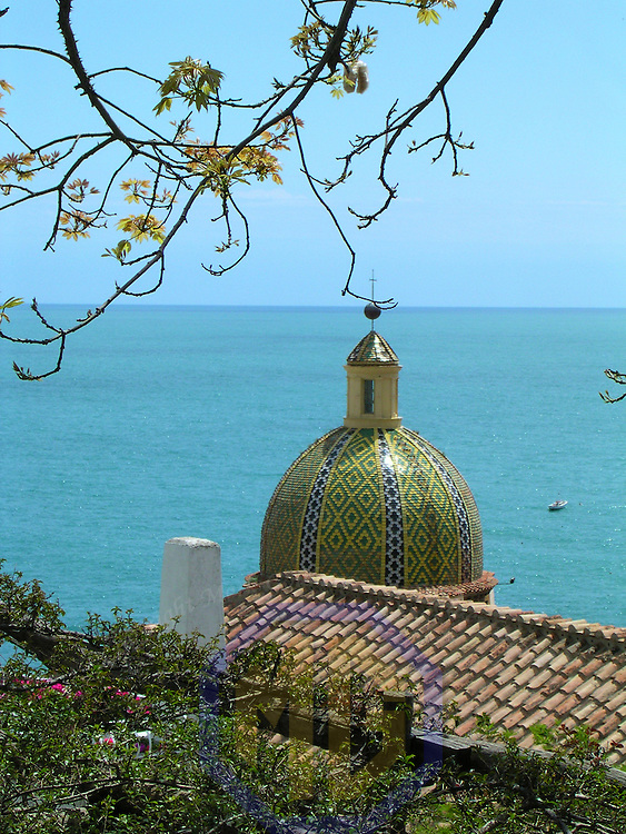 12 May 2004:  The tiled dome of Collegiate Church of Santa Maria Assunta (Parish Church or Mother Church) which dates back to 1200 in Positano, Italy, overlooking the Mediterranean Sea on May 12, 2004.