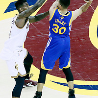 08 June 2016: Cleveland Cavaliers guard Iman Shumpert (4) defends on Golden State Warriors guard Stephen Curry (30) during the Cleveland Cavaliers 120-90 victory over the Golden State Warriors, during Game Three of the 2016 NBA Finals at the Quicken Loans Arena, Cleveland, Ohio, USA.