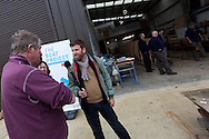 England, Emsworth, The Boat Project. 25  February  2011. Greg Whelan, Artistic Director, Lone Twin (holding microphone) interviewing a donator to The Boat Project.