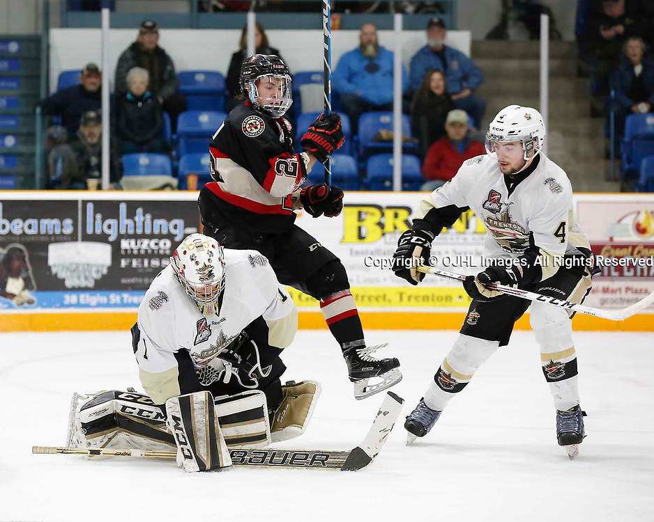 TRENTON, ON - MAR 7,  2017: Ontario Junior Hockey League, playoff game between the Trenton Golden Hawks and the Newmarket Hurricanes., Chris Janzen #1 of the Trenton Golden Hawks controls the puck during the second period<br /> (Photo by Amy Deroche / OJHL Images)