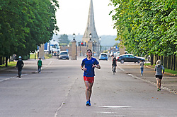 ©Licensed to London News Pictures 03/07/2020     <br /> Greenwich, UK. A man keeping fit with an early run. A sunny morning in Greenwich Park, Greenwich, London as people make a positive start to the day with some exercise. Photo credit: Grant Falvey/LNP