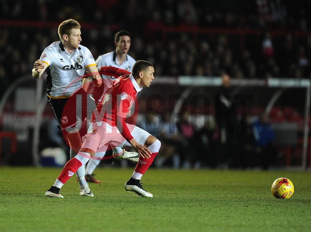 Bristol City's James Tavernier battles for the ball with Port Vale's Chris Robertson  - Photo mandatory by-line: Joe Meredith/JMP - Mobile: 07966 386802 - 10/02/2015 - SPORT - Football - Bristol - Ashton Gate - Bristol City v Port Vale - Sky Bet League One