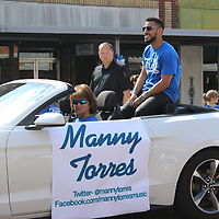 """RAY VAN DUSEN/MONROE JOURNAL FILE<br /> Season 15 """"American Idol"""" contestant Manny Torres rides in a parade in downtown Amory during Trent Harmon's Hometown Heroes film shoot for the show last year. Torres will return to Amory Thursday to headline the Amory Main Street Chilifest."""