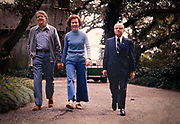President Jimmy Carter and First Lady Rosalynn Carter walk with New York City Mayor Abe Beame while on vacation at Musgrove Plantation in Georgia