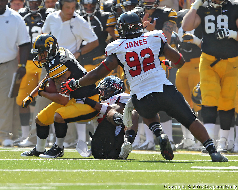 August 31 2013: Iowa Hawkeyes wide receiver Jacob Hillyer (17) tries to spin away from Northern Illinois Huskies cornerback Sean Evans (2) during the first quarter of the NCAA football game between the Northern Illinois Huskies and the Iowa Hawkeyes at Kinnick Stadium in Iowa City, Iowa on August 31, 2013. Northern Illinois defeated Iowa 30-27.