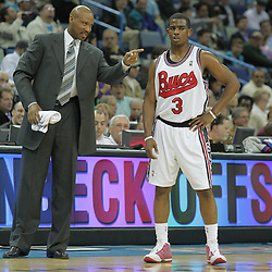 10 December 2008:  New Orleans Hornets head coach Byron Scott talks with guard Chris Paul (3) during a NBA regular season game between the Charlotte Bobcats and the New Orleans Hornets at the New Orleans Arena in New Orleans, LA. The game was an NBA Hardwood Classic with the Hornets dressed out in throwback uniforms honoring the former ABA franchise the New Orleans Buccaneers..
