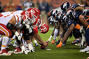 The Kansas City Chiefs offensive line gets set to snap the ball at the line of scrimmage opposite the Denver Broncos defensive line during the NFL week 4 regular season football game against the Denver Broncos on Monday, Oct. 1, 2018 in Denver. The Chiefs won the game 27-23. (©Paul Anthony Spinelli)