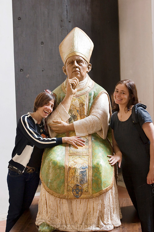 Jennifer and Faith ham it up with a statue of a pope in Pienza, Italy. (between Rome and Florence, near Montepulciano).