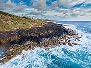 Aerial photograph of a mountain biker along the rugged east coast of Kauai, Hawaii