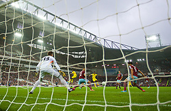 LONDON, ENGLAND - Saturday, September 20, 2014: Liverpool's Raheem Sterling scores the first goal against West Ham United during the Premier League match at Upton Park. (Pic by David Rawcliffe/Propaganda)