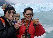 Japanese tourists enjoying a morning whiskey with glacier ice.