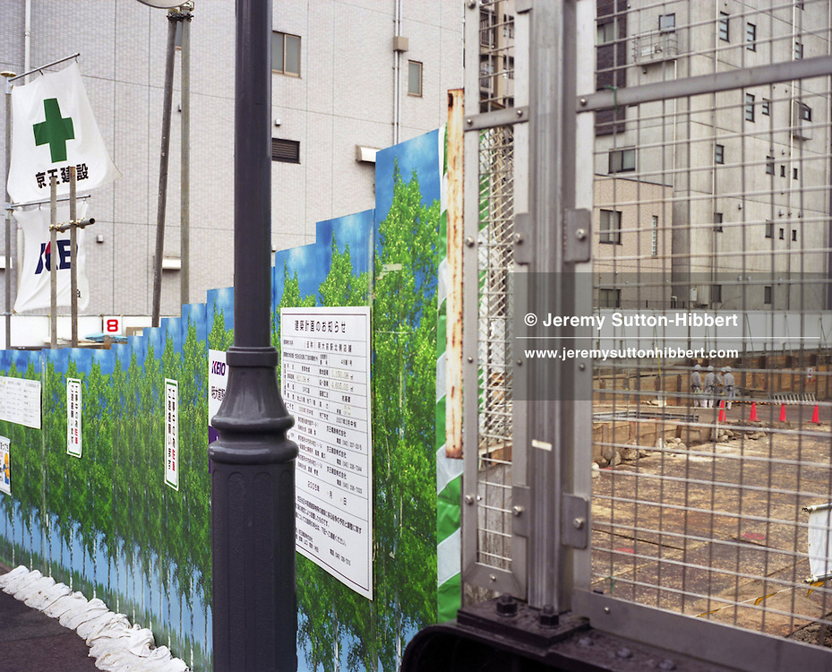 Hoardings decorated with tree motifs, erected to hide construction works behind, in Meidaimae district, Tokyo, Japan, October, 2007.