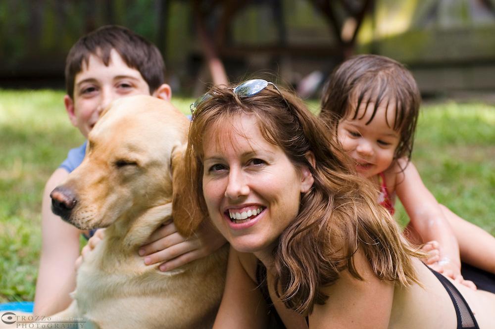 Family with pet labrador retriever dog